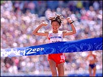 Naoko Takahashi as she crossed the finish line in Sydney