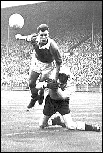 John Charles beats England goalkeeper Ray Wood at Wembley in November 1954
