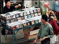 Street stall selling bootleg CDs and videos in Malaysia