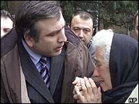 An elderly women in Poti, a town near the Ajarian border, pleads with Georgian president Mikhail Saakashvili to avoid an outbreak of hostilities with Ajaria