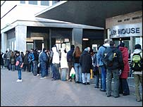 Migrants queuing
