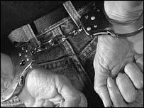 Man in handcuffs, BBC