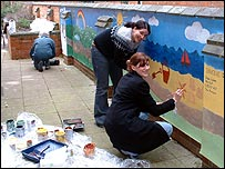 volunteers painting mural