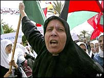 A Palestinian woman chants anti-Israeli slogans during a demonstration in Gaza