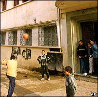 Boys play outside the Tangier apartment where Zougam grew up