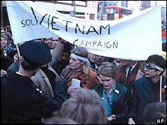 Vanessa Redgrave standing under a peace banner