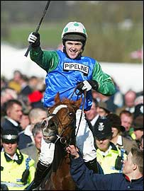Champion jockey Tony McCoy celebrates his win on Well Chief in the Arkle Trophy
