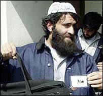 Former Guantanamo Bay detainee Hamanullah shows his prisoner tag
