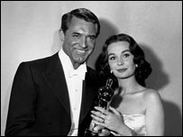 With Cary Grant at the 1958 Oscars ceremony