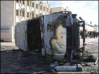 Burnt out car in Syrian town of Qameshli  