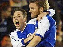 Neil Harris (left) celebrates his spectacular goal