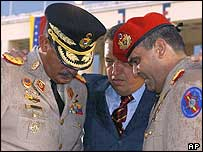 President Chavez with defence minister General Jorge Garcia Carneiro (l) and General Raul Baduel (r) in January 2004