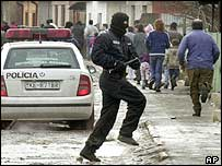 Masked police officers chase group of Roma near Trebisov