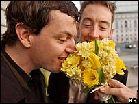 Gay couple smell flowers prior to their planned wedding in San Francisco