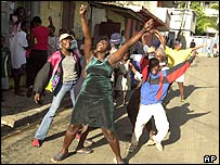 People celebrate in Cap Haitien at news of Mr Aristide's departure