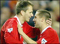 Dietmar Hamann is congratulated by Michael Owen on opening the scoring