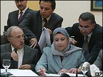 Council members Rajaa al-Kuzaai(L) and Mahmoud Othman(R)