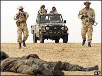 Malian soldiers enact an ambush exercise under the supervision of US Special Forces in the desert near Timbuktu
