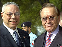 Colin Powell (left) is welcomed by Pakistani Foreign Minister Khurshid Mahmud Kasuri