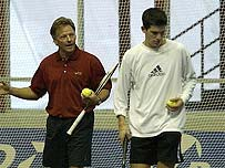 Tim Henman gets some coaching