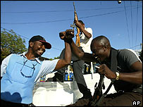 Rebels and police laugh as they patrol the streets of Port-au-Prince in Haiti