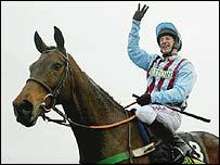 Jim Culloty celebrates Best Mate's achievement