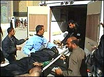 Victim of the blast in Karbala is carried to an ambulance