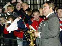 Jason Leonard carries the World Cup trophy outside 10 Downing Street