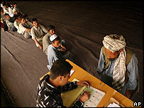 Afghan men in Kabul wait to register to vote