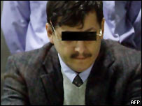 Marc Dutroux in court, picture masked under Belgian law