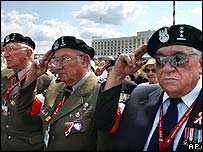 Warsaw Uprising veterans salute during a changing of the guards ceremony at the Tomb of the Unknown Soldier in Warsaw