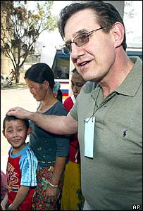 Randy Kelly (R) from St. Paul, Minnesota plays with ethnic Hmong children during his visit