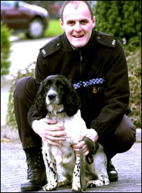 Police dog Todd and his handler Pc Roger Moore. Picture courtesy of the Lancashire Evening Telegraph
