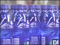 bottles of water on a factor conveyor belt