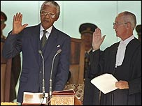 Nelson Mandela is sworn in as President in 1994