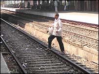 Man crosses tracks in Bombay