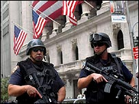 Armed police stand guard outside the New York Stock Exchange