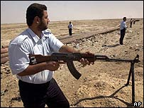 Iraqi police guard an oil pipeline