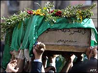Iraqis carry a coffin in Karbala