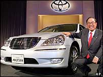 Toyota Motor's President Fujio Cho shows off the Crown Majesta luxury sedan