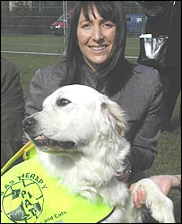 Blue, the golden retriever, with his owner Michelle Griffiths