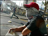 Clashes between security forces and demonstrators in Caracas