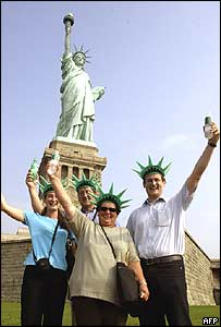 A Swiss family are among the first few thousand tourists to visit the reopened Statue of Liberty