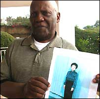 Former Ugandan President Godfrey Binaisa holding a picture of his new wife (Picture from The Monitor)