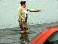 A woman stuck in the floods