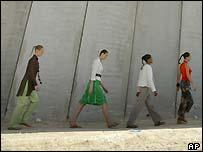 Fashion show along the West Bank barrier
