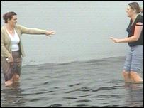 Women knee-deep in water
