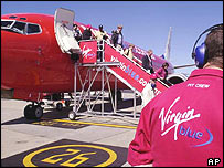 Virgin Blue worker and plane on runway