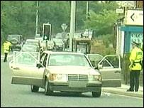 Police examine a car in Blackburn