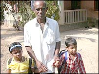 The children's grandfather, GeeVarghese John, with Bensy and Benson